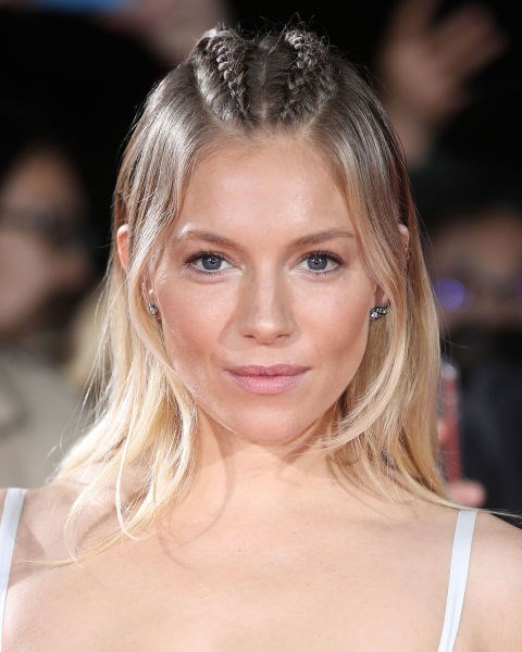 Sienna Miller with two Dutch braids.