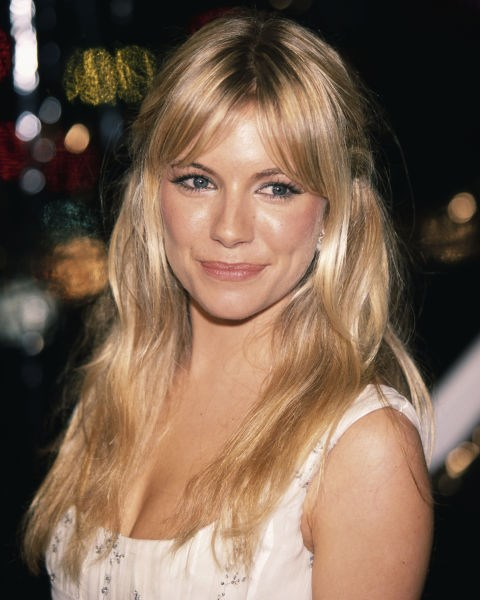 Sienna Miller with a fringe and long blonde hair.