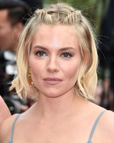 Sienna Miller with two twists.