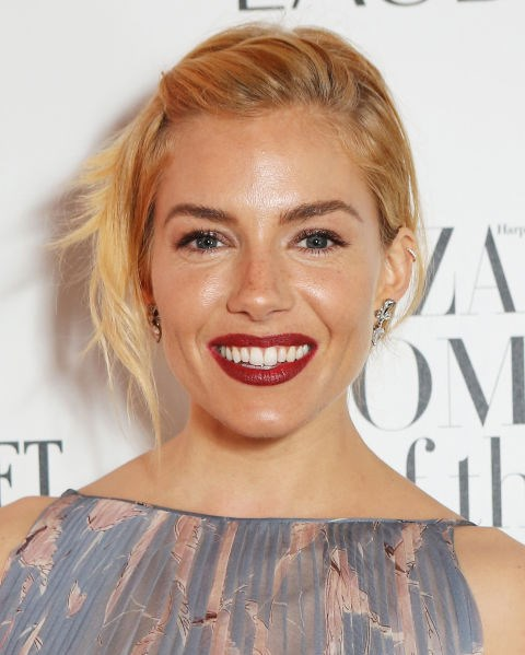 Sienna Miller with a twisted updo.