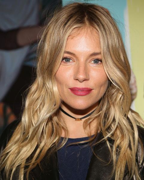 Sienna Miller with long blonde waves.