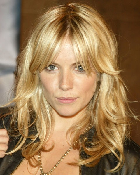 Sienna Miller with undone long blonde hair.