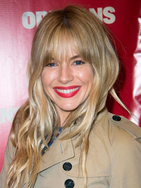 Sienna Miller with a full fringe.