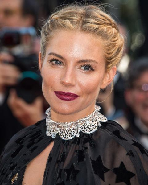 Sienna Miller with a plaited updo.