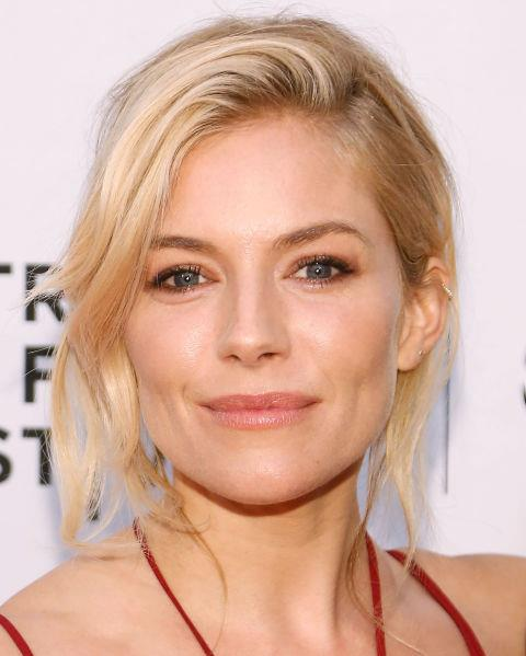 Sienna Miller with a tousled updo.