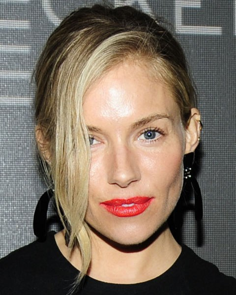 Sienna Miller with a side-parted updo.