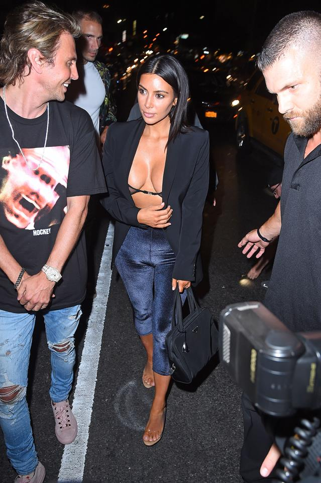 Kim stepped out overnight in New York wearing a sheer bra underneath a sharp black blazer.