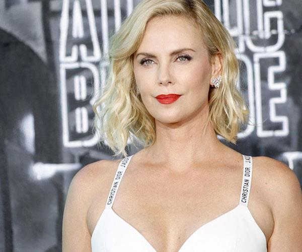 Charlize Theron Opens Up Again ABout Her Traumatic Childhood