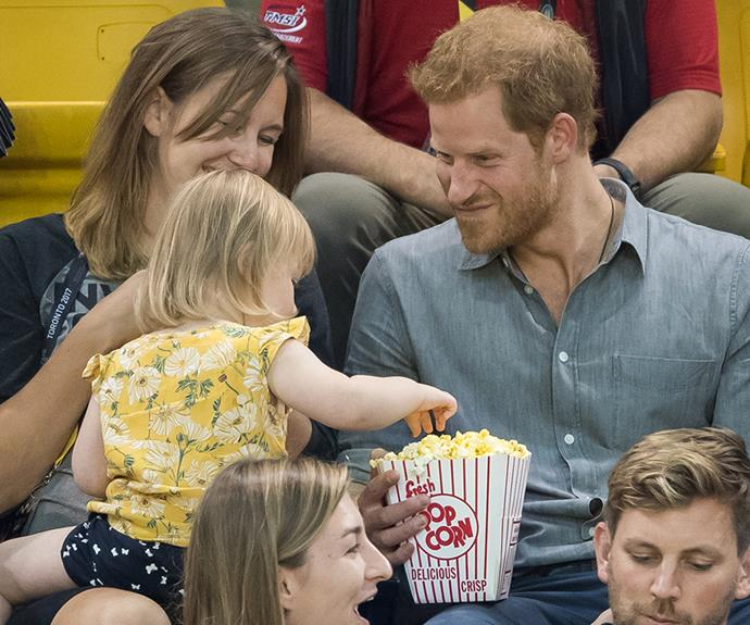 Prince Harry and a baby.
