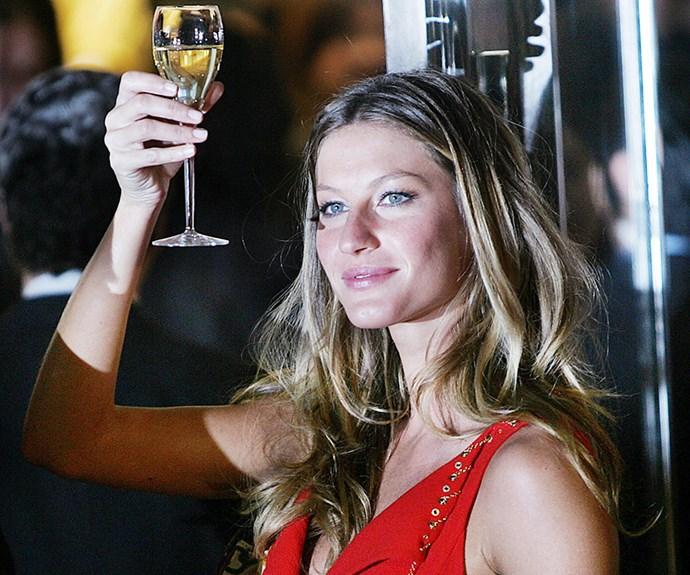 Gisele Bundchen drinking wine.