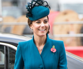 Kate Middleton in a teal Catherine Walker coat-dress.