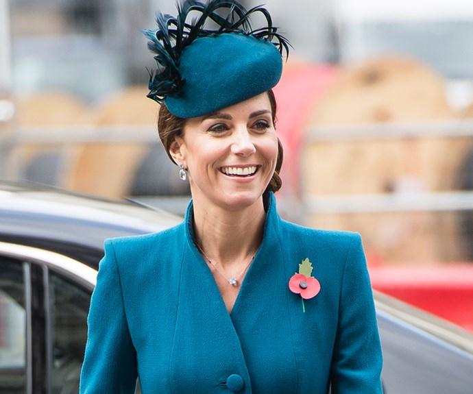 Kate Middleton in a teal Catherine Walker coat-dress.
