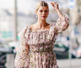 Woman wearing a floral ruffled dress street style