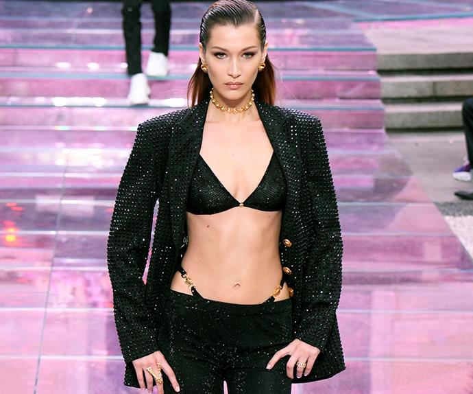 Bella Hadid walking the Versace Men's spring/summer show in 2019.