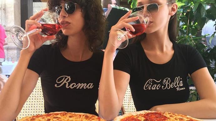 Bella Hadid eating pizza.