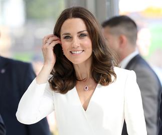 Kate Middleton wearing a white dress.