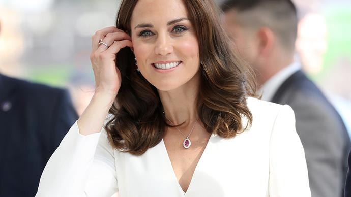 Kate Middleton wearing a white dress.