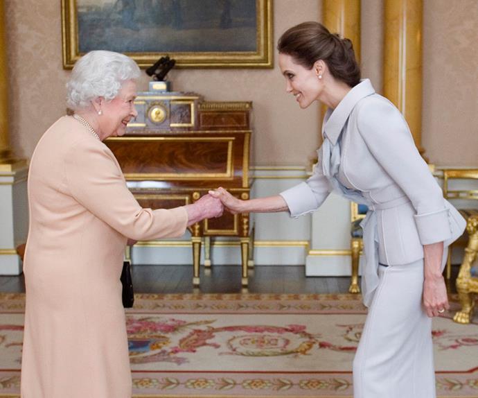 Angelina Jolie meeting Queen Elizabeth II.