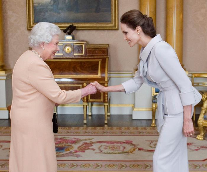 Angelina Jolie meeting Queen Elizabeth II.