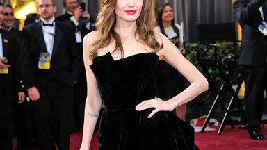 Angelina Jolie Reprises Her Love Of The Leg Slit Dress While Promoting Her New Film