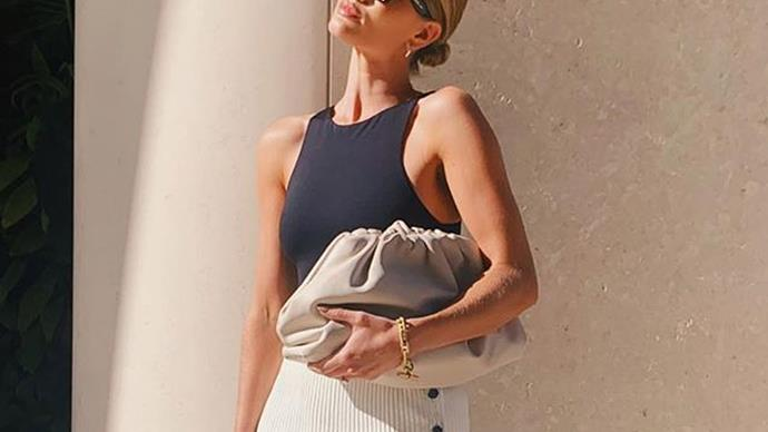Rosie Huntington-Whiteley carrying Bottega Veneta Pouch Bag.