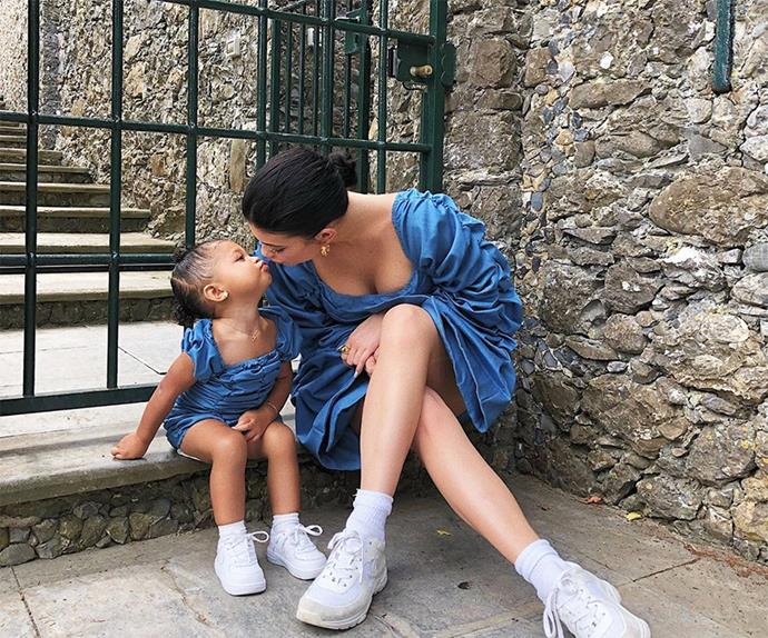 Kylie Jenner and Stormi Webster in matching blue dresses.