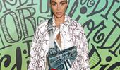 Kim Kardashian Steps Out In Menswear At Dior's Miami Show