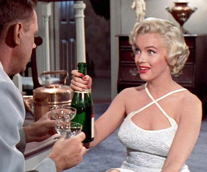 Jacqueline Bisset drinking champagne.