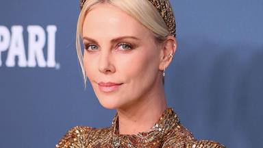 Charlize Theron Shimmers In Head-To-Toe Gold Louis Vuitton