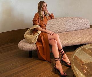 Rosie Huntington-Whiteley wearing Bottega Veneta sandals.