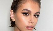 Kaia Gerber's Makeup Artist Says 'Brow Balm' Is The Key To Building Bold, Bushy Arches