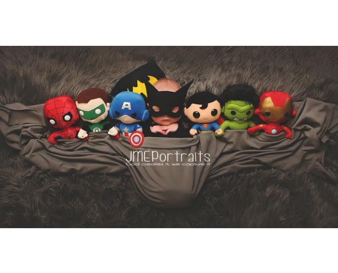 Check out baby Batman and his superhero friends!  Photo via JME Portraits