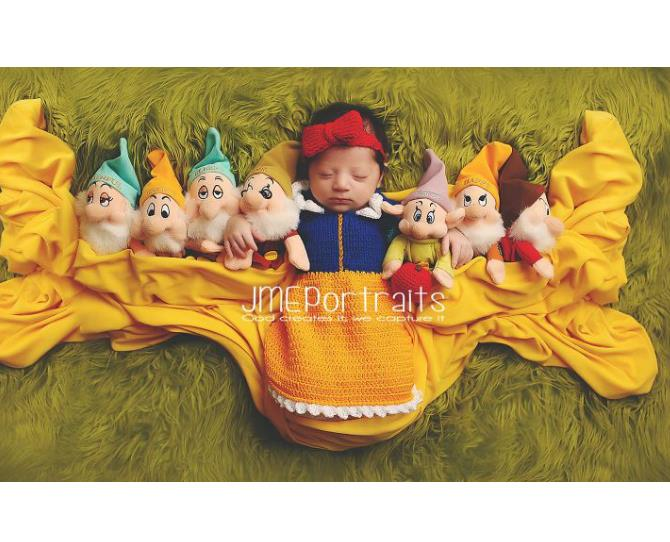 Snow White with her seven dwarves could pass as Sleeping Beauty in this newborn photoshoot.  Photo via JME Portraits