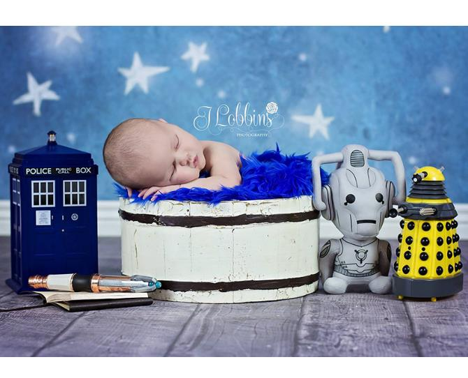 Doctor Who fans take their passion to the next level in this newborn shoot. Complete with TARDIS, Cyberman and Dalek - this baby is destined to be a Sci-Fi fan judging by his parents!  Image via J. Lobbins Photography