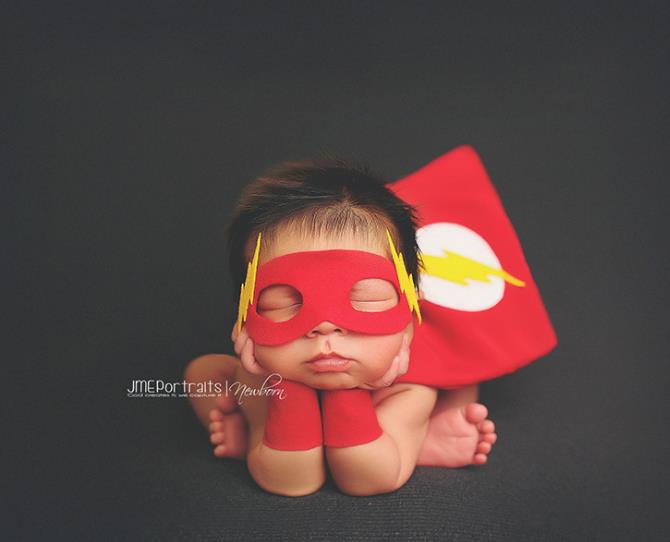Don't mess with baby Flash! His cuteness is a deadly weapon.  Photo via JME Portraits