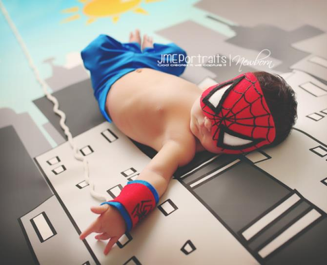 Why be an ordinary little newborn, when you can be a newborn superhero?!  Photo via JME Portraits