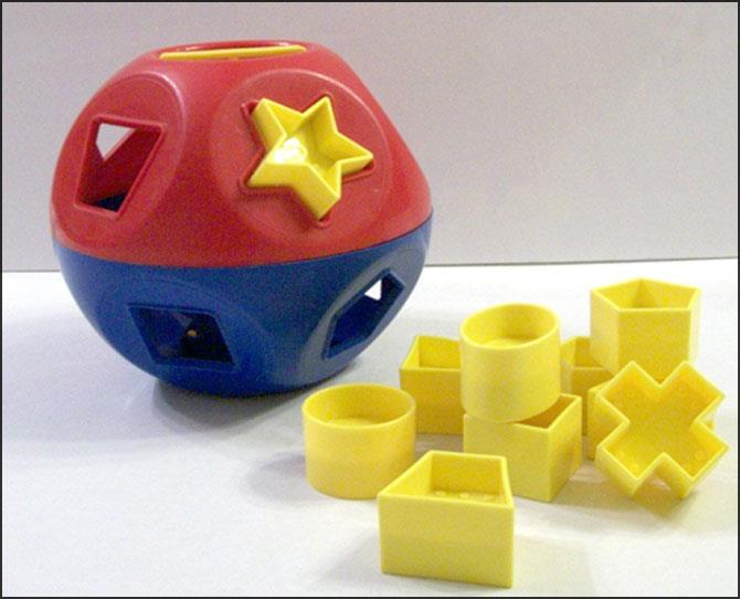 **Shape-O**: A shape-fitter that helps kids to learn about why a square peg can never fit in a round hole. Tupperware was one of the first to release this classic fun toy in 1968 and it has remained largely unchanged in all but colour ever since.