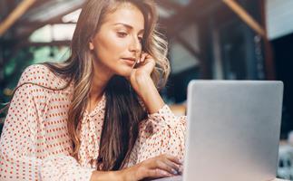 woman googling computer cafe