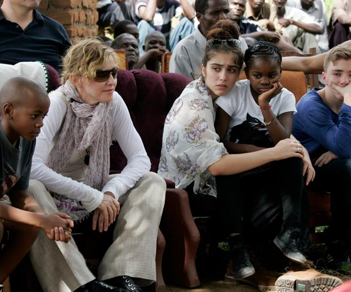 Madonna sits with her biological and adopted children (L to R) David Banda, Lourdes, Mercy James, and Rocco.