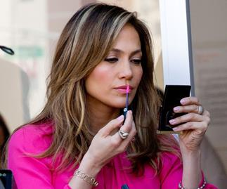J-Lo applying lipstick