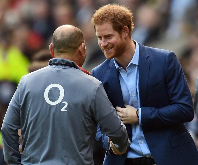 Prince Harry shakes hands with England's head coach, Aussie Eddie Jones.