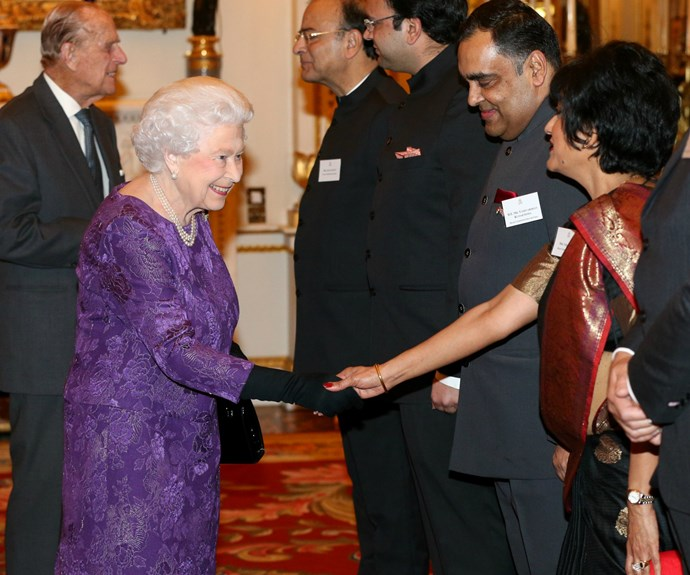 The Queen looked elegant in one of her favourite colours: purple.