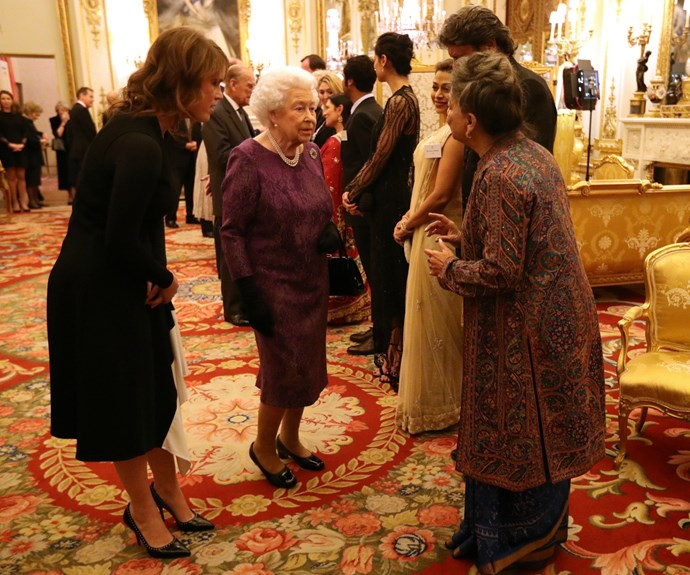And there it is... the Queen's trusty black handbag!