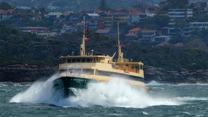 Sydney deckhand captures incredible image of gigantic waves crashing into the Manly ferry