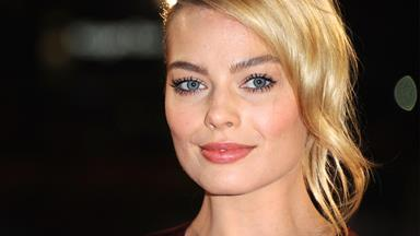 Keep your tights on... Margot Robbie is set to steal from the rich and give to the poor!