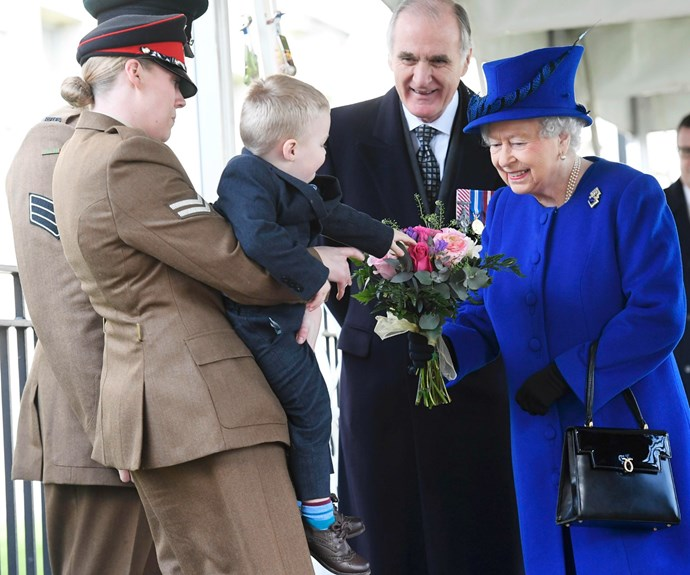 The two-year-old son of a war hero couple brought a smile to the Queen's face.