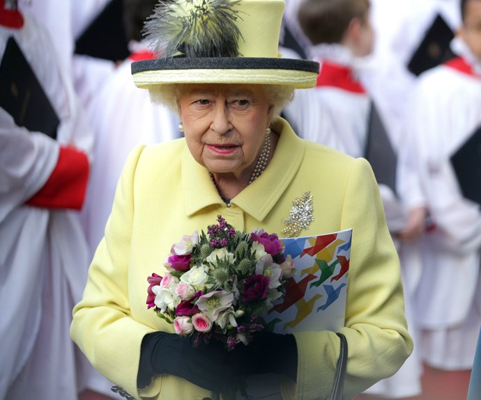 The Queen, with a jaunty feather in her hat, looked as sprightly as ever in a lemon-coloured ensemble.