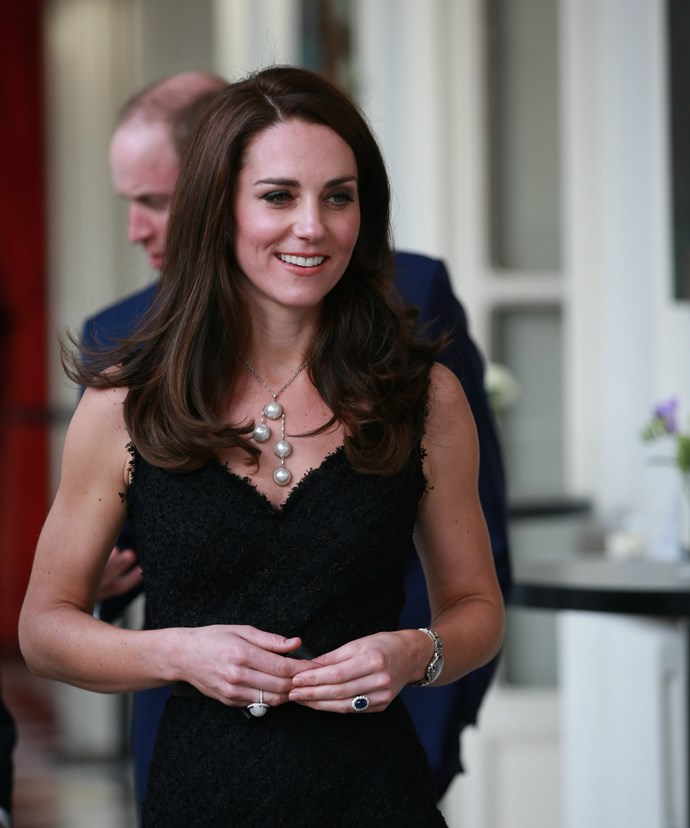 "Flying the flag for British fashion! Kate was snapped in a stunning black gown designed by Alexander McQueen as she made her way to the prestigious event, ""Les Voisins."""