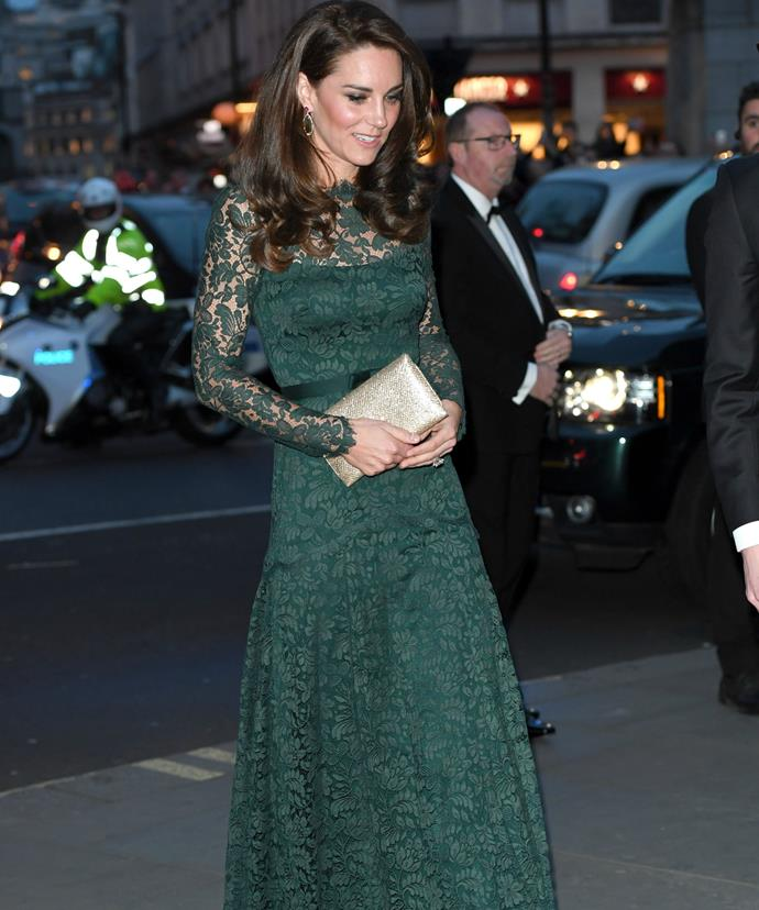 Kate revamped the ensemble with a flash of gold in the form of a snakeskin clutch.