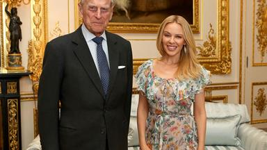 She should be so lucky! Prince Philip has Queen of Pop Kylie Minogue in giggles